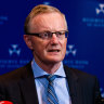 RBA governor pushes back against review of the bank as economists say it's time