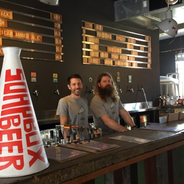 Scott Robertson and Luke Nixon, owners of Soapbox Beer in Fortitude Valley, at the bar in their new craft beer pub.