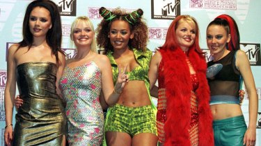 Victoria Beckham (left) with the Spice Girls in 1997.