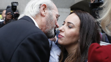 Julian Assange's father John Shipton and girlfriend Stella Morris greet each other in front of the Central Criminal Court Old Bailey in London.