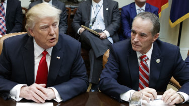 Republican Congressman Chris Collins (right) pictured with Donald Trump. Collins has been arrested by the FBI.