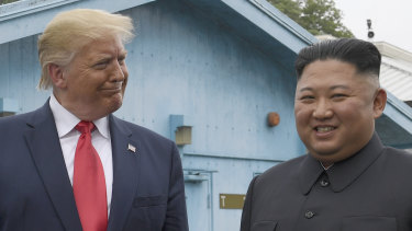 Donald Trump and Kim Jong-un in the Demilitarised Zone on Sunday. Despite three historic meetings, North Korea hasn't  dialled down its nuclear ambitions.