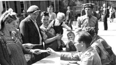 Families receive new papers in Hamburg following the end of the war.