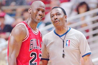 Michael Jordan shares a laugh with NBA referee Hue Hollins in 1996.