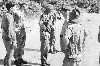 Jock McLaren (centre) seen with an Australian inspection party on Berhala Island in Sandakan Bay