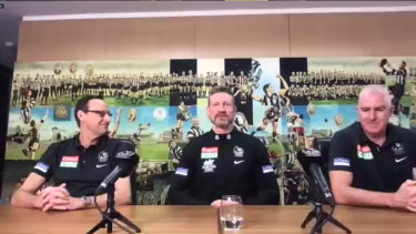 Collingwood CEO Mark Anderson (left), GM of football Graham Wright (right), and senior coach Nathan Buckley (centre).