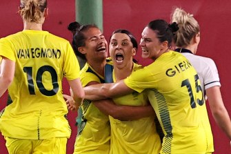 Sam Kerr celebrates her second goal against Great Britain.