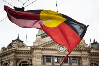 The Indigenous flag on show in the streets of Melbourne.