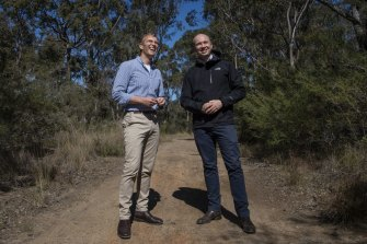 Minister for Planning and Public Spaces, Rob Stokes (left) with  Minister for Energy and Environment, Matthew Kean, at St Helens Park near an area that is part of Sydney's sprawling south-western edge.