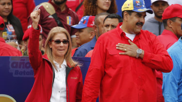 Venezuelan President Nicolas Maduro and first lady Cilia Flores acknowledge supporters at the end of a rally in Caracas.