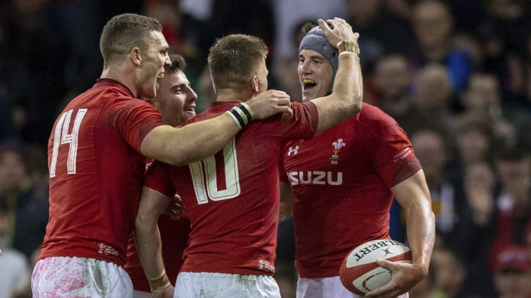 Strong start: Wales celebrate a try en route to victory over Scotland.