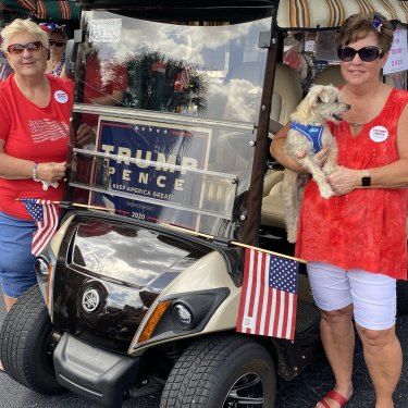 Friends Dorothy Sullivan and Carol McNeal at a pro-Trump golf cart parade in The Villages, Florida.