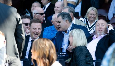 Mal Meninga and Ben Fordham watch on at the memorial.