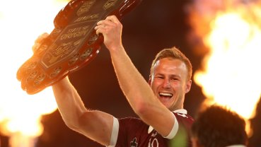 Daly Cherry-Evans hoists the Origin shield aloft.