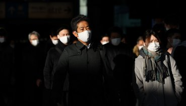Commuters wear face masks in Tokyo earlier this month.