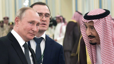 Russian President Vladimir Putin, left, and Saudi Arabia's King Salman talk during their meeting in Riyadh, Saudi Arabia.