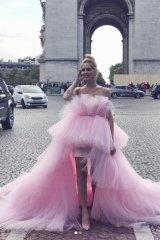 Italian fashionista Chiara Ferragni in her mullet dress in front of the Arc de Triomphe in Paris.