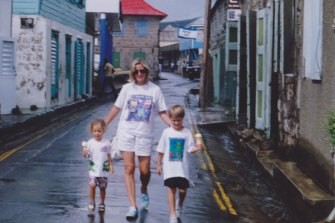 Australian film producer Cody Greenwood, left, as a child with her mother Frane Lessac and brother Luke on Montserrat in 1993.