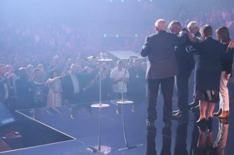 Prime Minister Scott Morrison receives a blessing at the Australian Christian Churches conference.