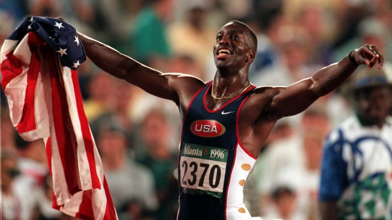 Michael Johnson of the United States celebrates after winning gold in the men's 200 metres in a new world record time of 19.32 at the 1996 Summer Olympic Games.