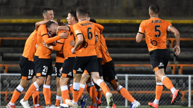 The Roar celebrates after Stefan Mauk's goal against Sydney FC.