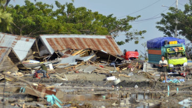 A man stands amid the damage caused by a tsunami in Palu.