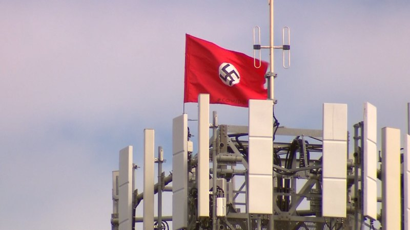 Suspected trespassers fly swastika Chinese flags from phone tower – The Age
