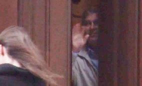 Prince Andrew, inside the mansion of convicted paedophile Jeffrey Epstein, appears to wave goodbye to a woman.
