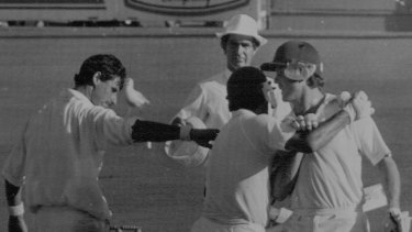 Craig McDermott and Mike Whitney celebrate the 1987 draw with New Zealand as Richard Hadlee offers his congratulations.