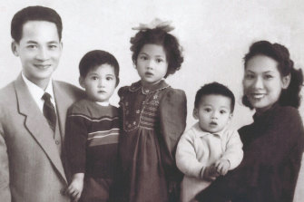 Andrew Kwong (second from right) is held by his mother in a family photo taken in the 1950s.