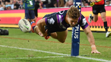 Air time: Ryan Papenhuyzen dives to score during the Storm's hammering of the Eels in Brisbane.