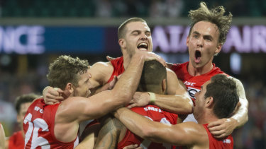 True grit:  The Swans celebrate a Lance Franklin goal against West Coast on Sunday.
