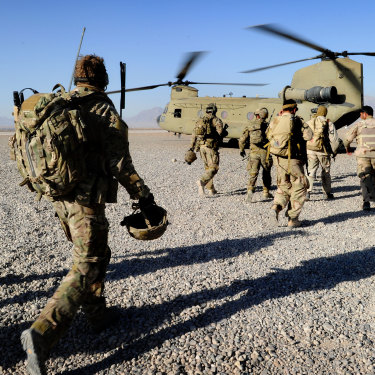 Australian troops from Special Operations Task Group and their Afghan counterparts from the Provincial Response Company walk to a CH-47 Chinook aircraft ahead of a mission.
