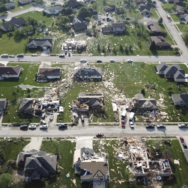 Damaged homes and debris marking the path of a tornado in Celina, Ohio.