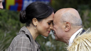 """Meghan, the Duchess of Sussex, receives a """"hongi"""" a traditional Maori welcome on the lawns of Government House in Wellington, New Zealand,"""