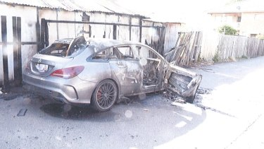 A silver Mercedes, used as a getaway car, was set on fire.