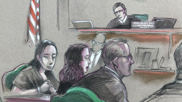 In a courtroom artist's sketch, Chinese woman, Yujing Zhang, left, listens to a hearing.