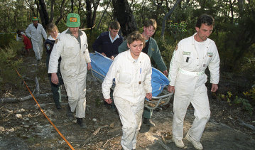 Rescue workers remove the body of a female British backpacker after it was discovered in the Belanglo State forest in 1992.