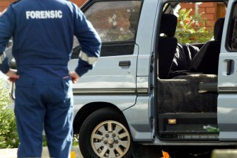 Police examine the van in which Jason Moran and Pasquale Barbaro were murdered.