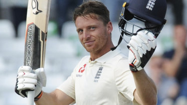 Brave knock: Jos Buttler celebrates his maiden Test century.