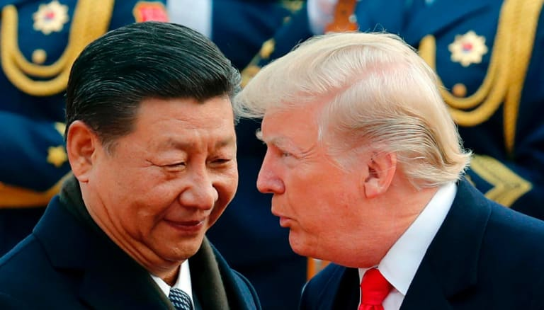 Risky standoff : Chinese President Xi Jinping with US President Donald Trump.