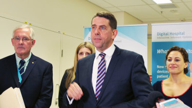 Dr Richard Ashby, Queensland Health Minister Cameron Dick and Queensland Deputy Premier Jackie Trad speak to reporters as the advanced ieMR system goes live at Princess Alexandra Hospital.