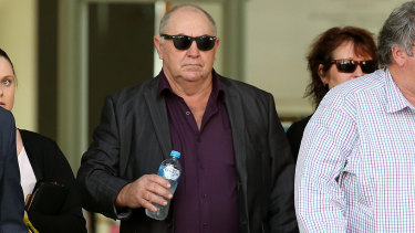 Edward Pye (centre) leaves the courthouse in Brisbane.