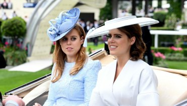 The Queen is said to adore princesses Beatrice and Eugenie, pictured here at Royal Ascot.