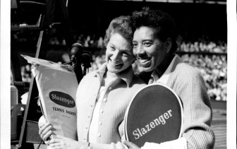 Britain's Angela Buxton (left) and America's Althea Gibson. They had just defeated the Australian pair, Fay Muller and Daphne Seeney in the women's doubles final at Wimbledon  July 09, 1956.
