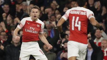 Arsenal's Aaron Ramsey (left) celebrates his team's first goal against Napoli in the Europa League.