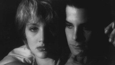 Mae (Jenny Wright) and Caleb (Adrian Pasdar) together in the stylish vampire movie Near Dark.