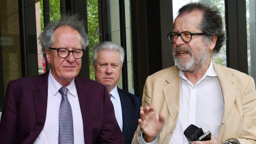 Theatre director Neil Armfield outside the Federal Court last week with Geoffrey Rush.