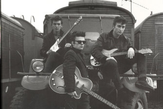 George Harrison, Stuart Sutcliffe, and John Lennon of the Beatles pose for a portrait in Liverpool in this 1959 photo.