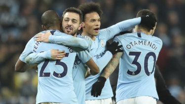 Manchester City celebrate their win over Liverpool.